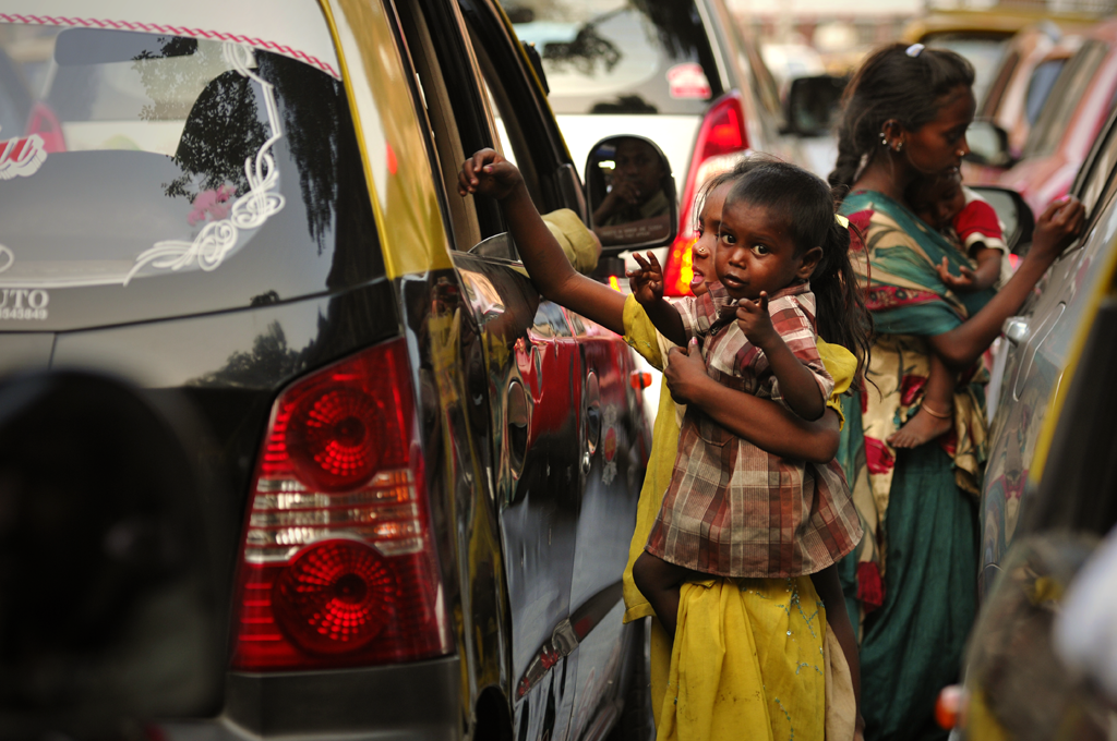 Photo of street children begging in Mumbai in India.