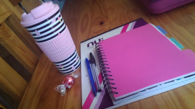 student materials and coffee mug