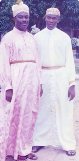 A young Don Jazzy and his father in white garment church outfit.