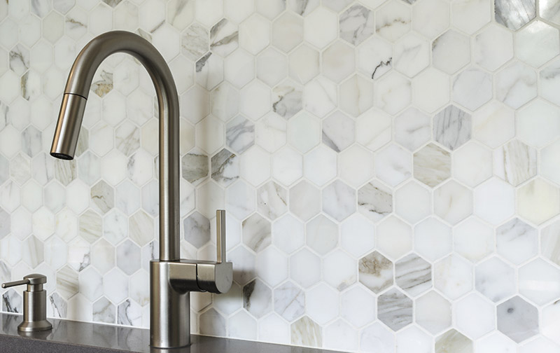 white grout with marble tiles