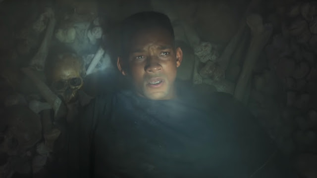 digitally de-aged will smith and a skull