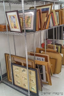 Photo of the second-hand art selection available for sale at a local thrift store by Cramer Imaging