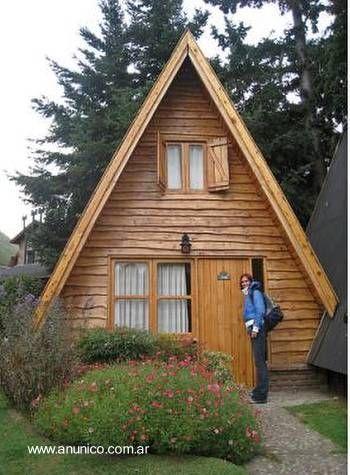 rumah kayu atap tinggi
