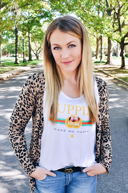 Girl wearing Leopard Cardigan and Puppy Tee on a tree lined street