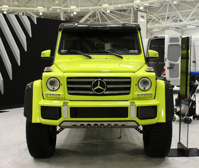 Neon Mercedes truck at the Twin Cities Auto show