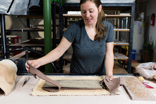 "Bethany Kramer handbuilding a ""taco plate"" serving tray."