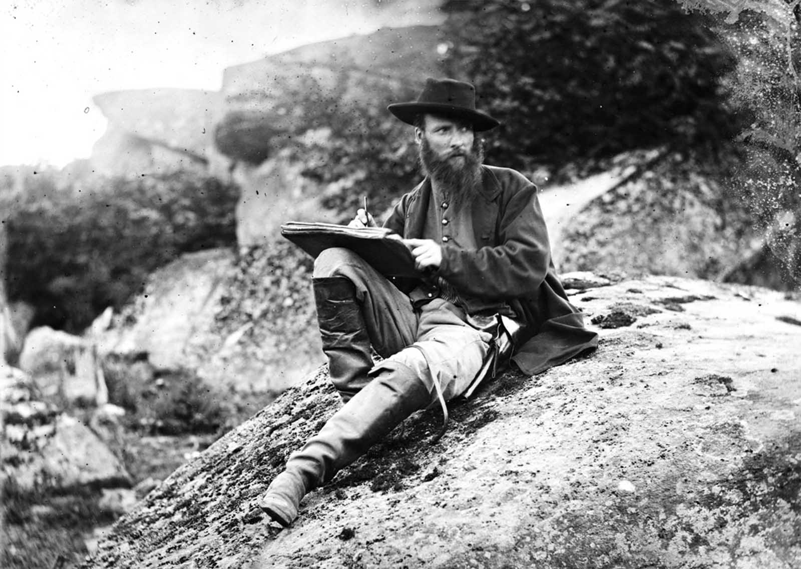 Photographer Timothy H. O'Sullivan took this photo, one half of a stereo view of Alfred R. Waud, artist of Harper's Weekly, while he sketched on the battlefield near Gettysburg, Pennsylvania in July of 1863.