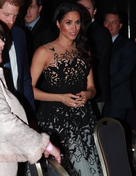 Meghan Markle wore Oscar de la Renta white tulle gown, tweed laser cut birds, from Pre-Fall 2018 collection. Aquazzura Deneuve pumps