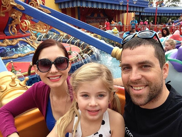 family on a ride at Disney