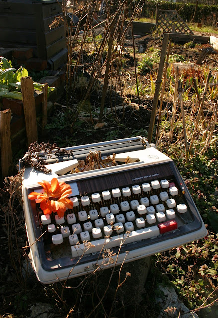Garden decor with found objects: typewritter