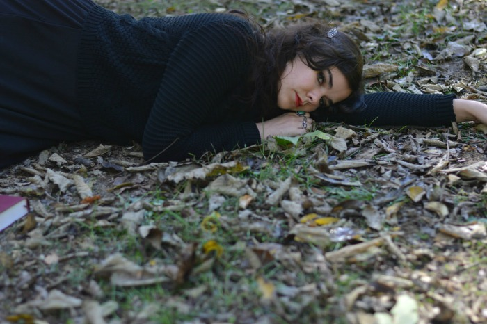 girl laying in the woods in autumn