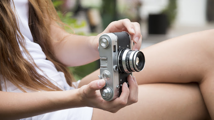 Wallpaper: Miss with a Retro Camera