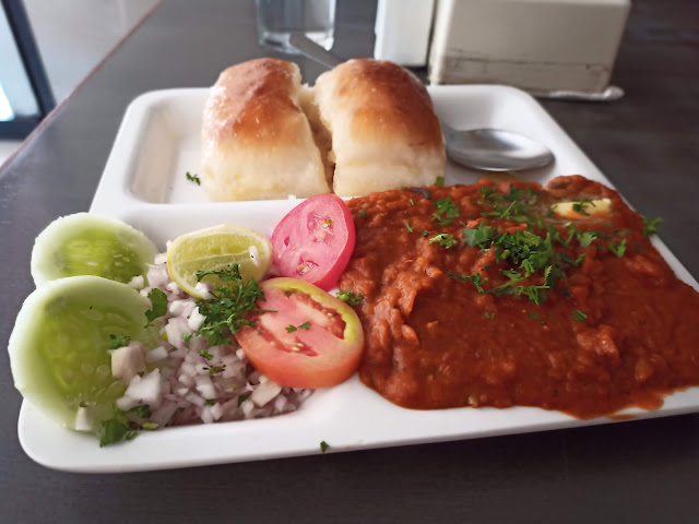 Pav Bhaji, a vegetable curry with bread rolls and side salad