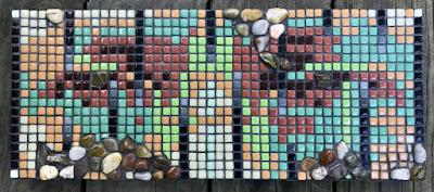 A few pebbles reminding of the Grandiose Pella Mosaics