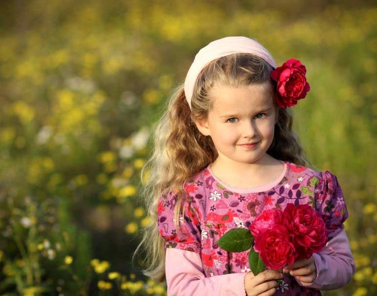 adorable girl with roses in hand