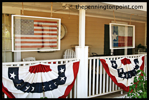 This front porch adorned with American flag decor is vintage and patriotic.