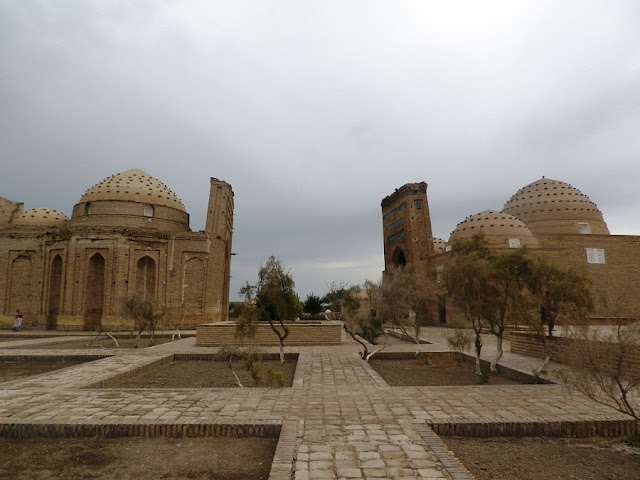 Image Attribute: The ancient Nejameddin Kubra and Sultan Ali Mausoleums lean in as if to finally touch / Photography provided by Stephen M. Bland / All rights reserved with the author.