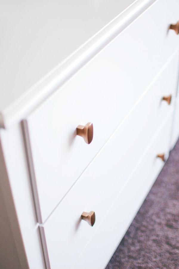 Master bedroom dresser with gold knobs