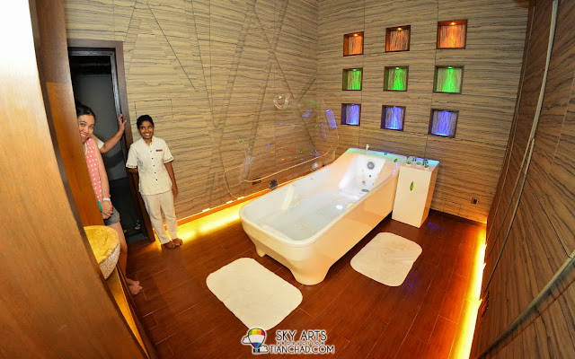 A very cool water-spa with aromatic oil in the water-massage bath-tub