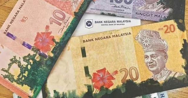 Terima Duit Kertas Berdakwat? Waspada Ia Mungkin Duit Rompakan ATM