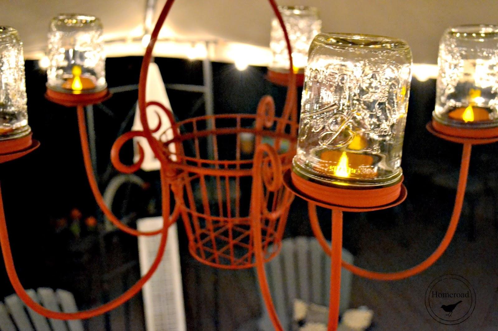 Outdoor chandelier with mason jar tea lights