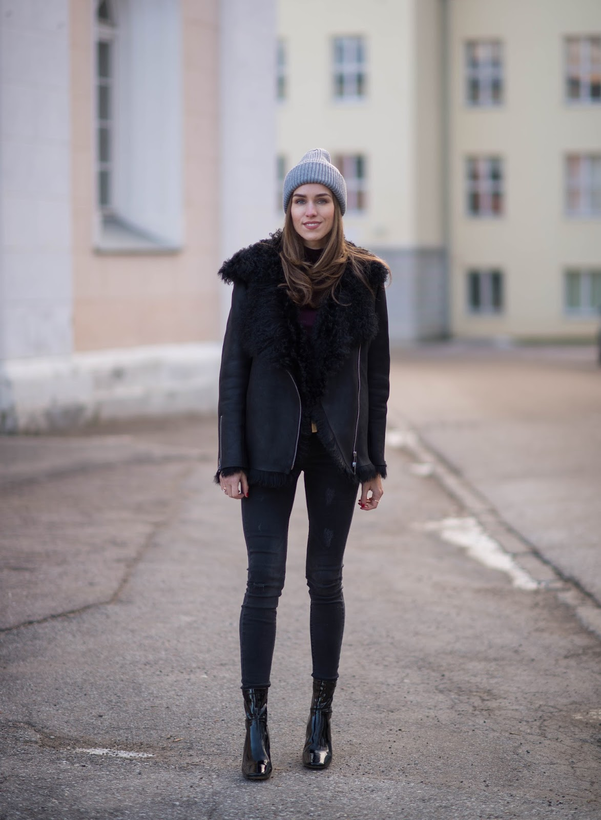 all black winter outfit shearling jacket patent boots