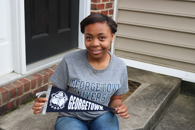 Lauren Alston wearing her Georgetown University tee shirt.