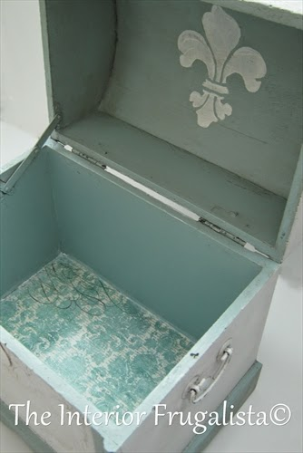 Small decorative trunk makeover After with the bottom lined in vintage scrapbook paper