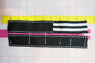 ribbon pinned to right side of zipper