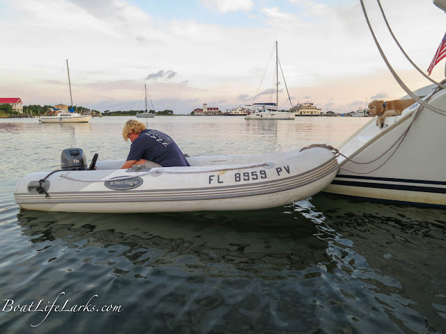 Fixing the dinghy in Silver Lake, Ocracoke