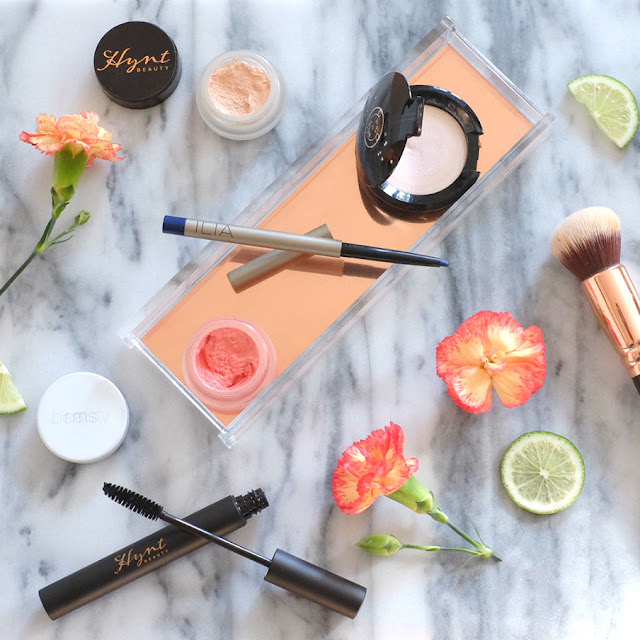 5 Product Face in 5 Minutes featuring Hynt Beauty's DUET Perfecting Concealer; RMS Beauty Lip2Cheek in Smile; Rituel de Fille Rare Light Luminizer in Ghost Light; Ilia Beauty Pure Eyeliner in Nightclubbing; and Hynt Beauty NOCTURNE Mascara.