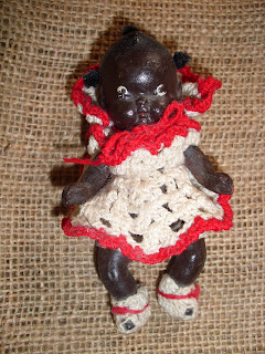 AllThingsVintage Porcelain Black Americana Jointed Baby Doll