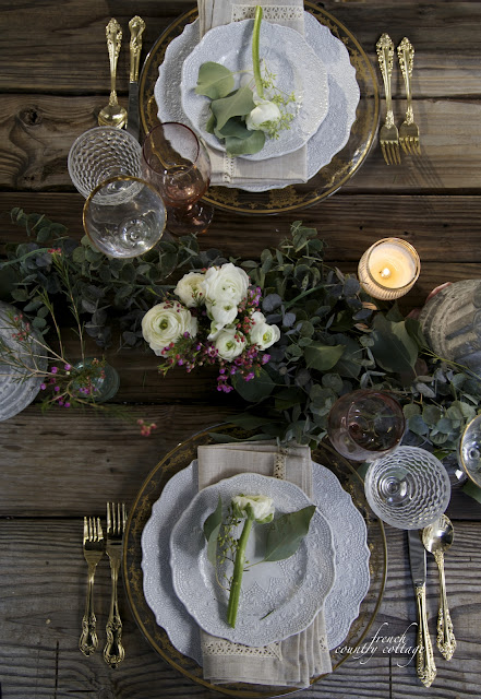 Rustic table top set with elegant china and eucalyptus garland