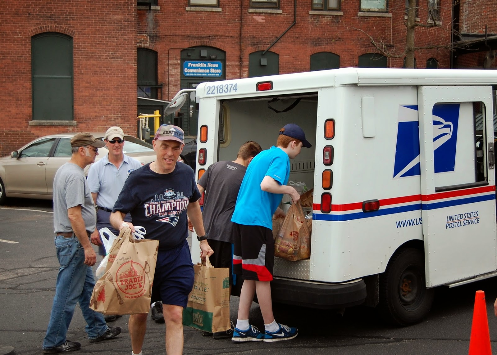 volunteers unloading the truck