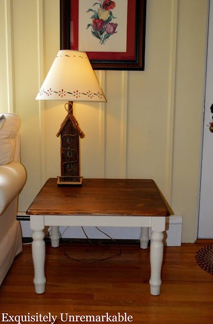 Old Ikea Wooden table with a birdhouse lamp on it