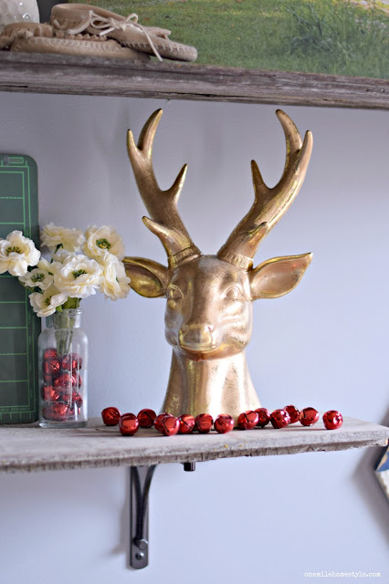Rustic Gold Christmas deer decorations with festive red accents