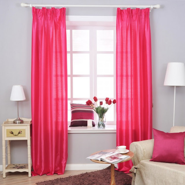 Drapery should be hung at least 4 to 6 inches above the top window trim