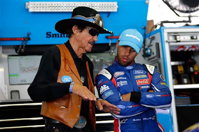NASCAR Hall of Famer and team owner Richard Petty speaks with Darrell Wallace Jr., driver of the #43 Smithfield Ford, in the garage area during practice for the Monster Energy NASCAR Cup Series Axalta presents the Pocono 400 at Pocono Raceway on June 9, 2017 in Long Pond, Pennsylvania.