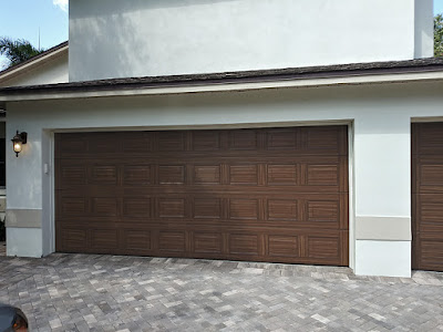 double garage door painted to look like wood