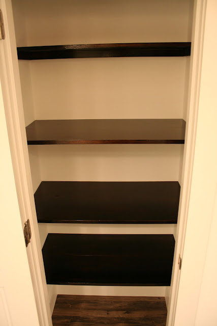 Dark Polyshades stained bathroom closet shelves in Espresso gloss | The Lowcountry Lady
