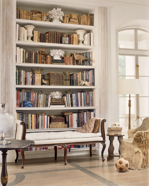 Beautiful library shelves with books in French inspired home in Houston by Murphy Mears