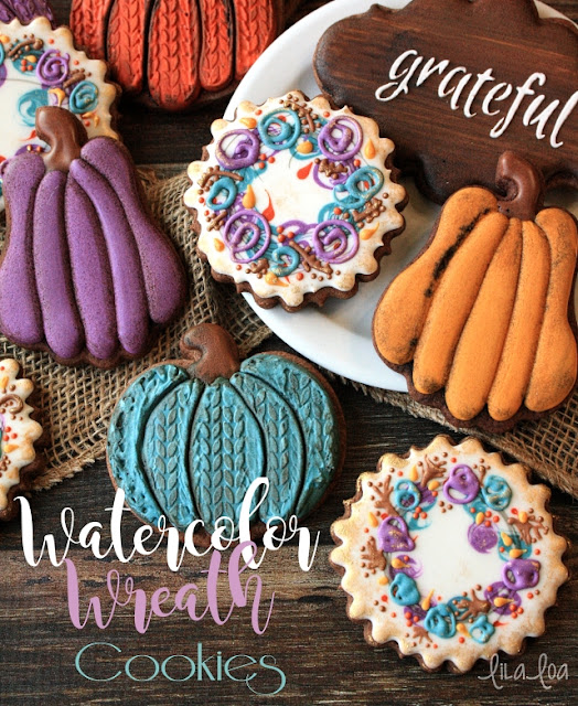 Decorated sugar cookies that look like water color wreaths -- tutorial