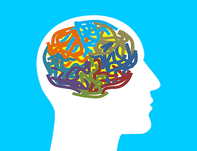 drawing of a profile of a person with colorful squiggly lines in the brain area