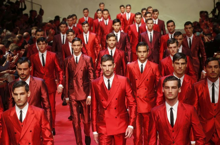 Models wear creations for Dolce & Gabbana men's Spring-Summer 2015 collection, part of the Milan Fashion Week, unveiled in Milan, Italy, Saturday, June 21, 2014.