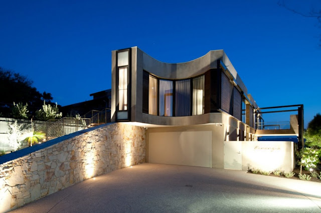 Lit up modern home from the driveway