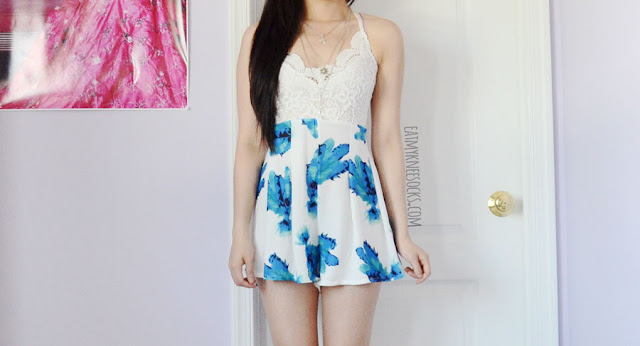 Details on the white and blue lace-trim v-neck cutout back halter floral romper playsuit from Dresslink.