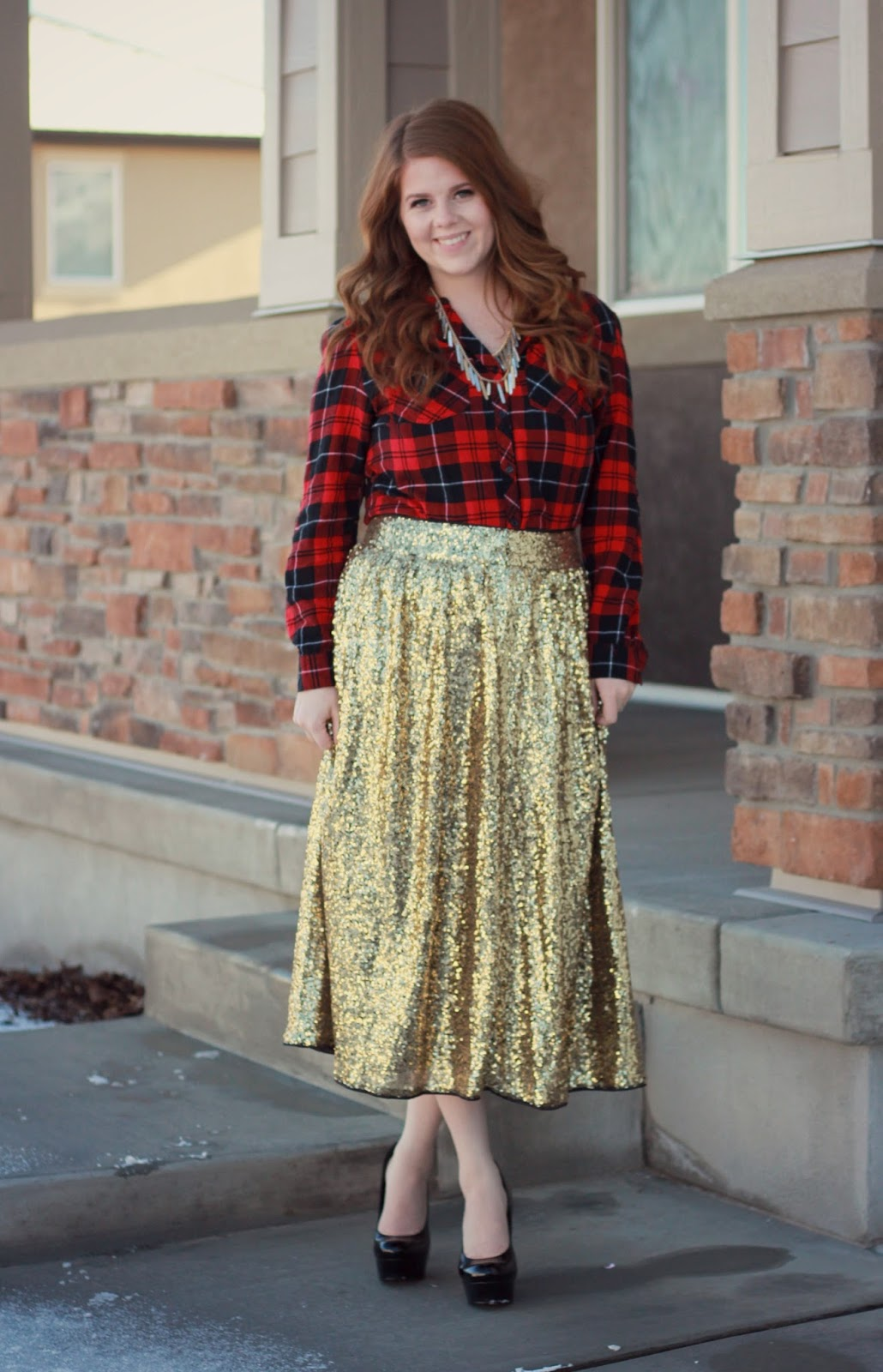 Gold sequin skit and red plaid top