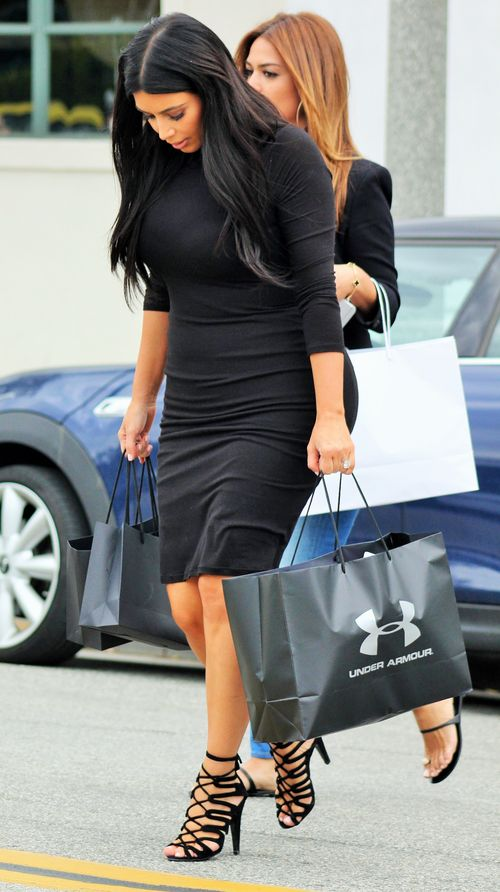 Pregnant Kim Kardashian with Micro-tummy in tight dress