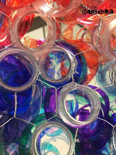 Recycled Chihuly-inspired art using water bottles and markers