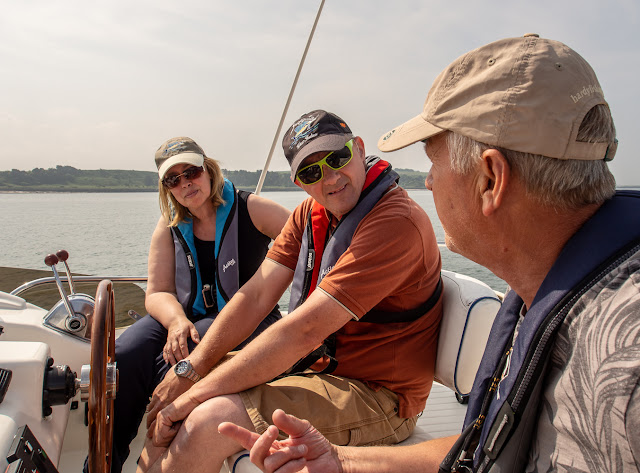 Photo of Phil chatting with Traver and Julie on Andromeda's flybridge